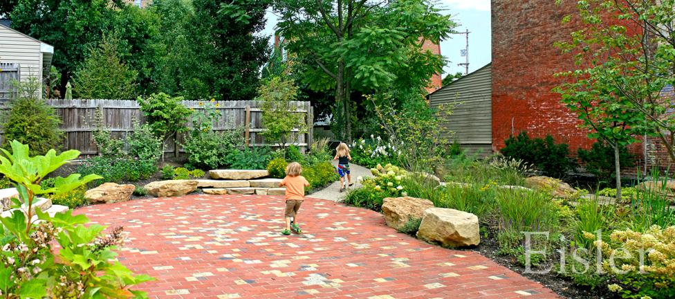 Kids racing scooters in the garden.