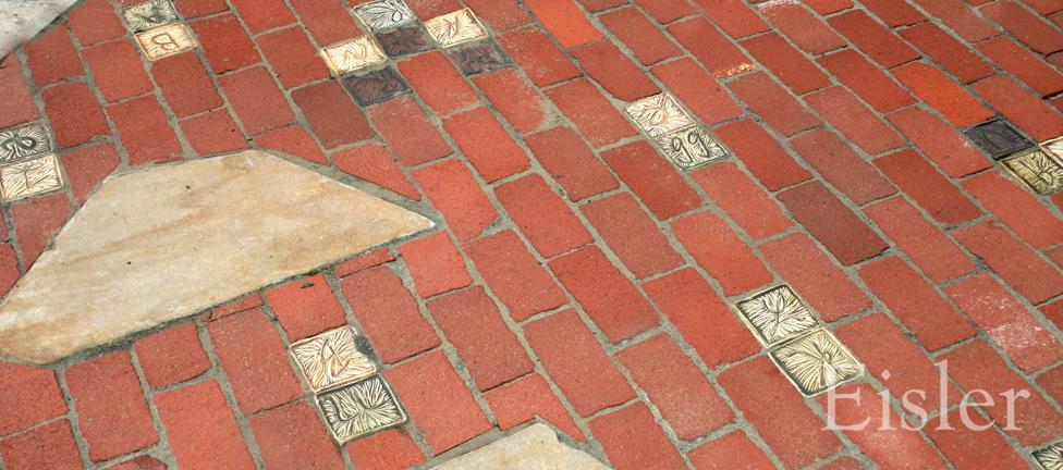 Custom paving of artist made alphabet pavers, stone and brick.