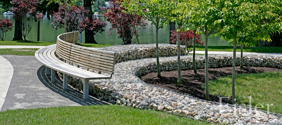 Gabion walls and curved benches at Aspinwall Riverfront Park.
