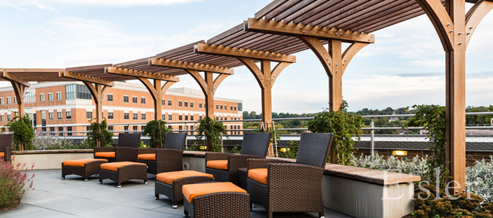 Curved arbor and seating area at Mario Lemieux Cancer Center.