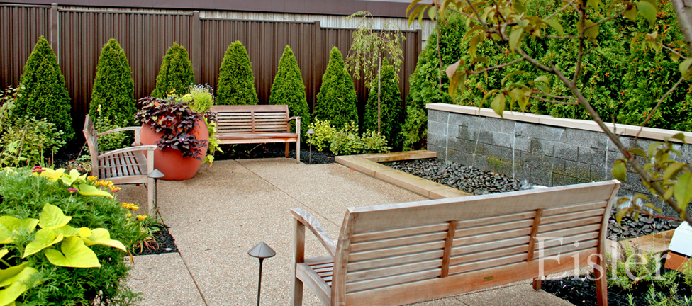 Waterfall and seating area in St. Margaret's Garden of Hope.